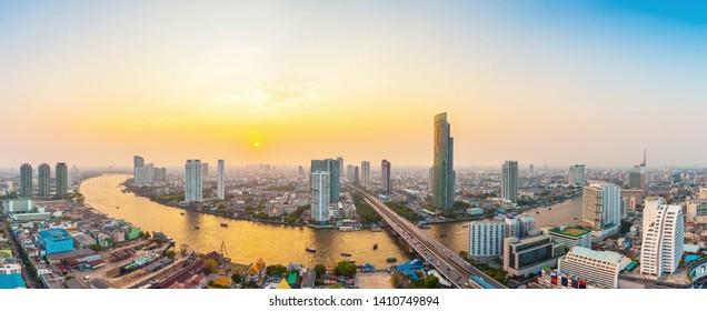 Beautiful view of Bangkok city with Chaopraya river at sunset. Panorama photo.