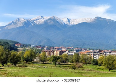 Beautiful view of the Bansko. Snow covered peaks of the Pirin mountains on background - Pirin National Park, Bulgaria