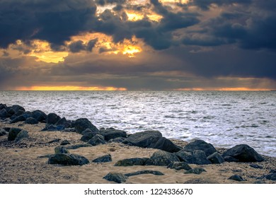 Beautiful view from the beach with shells, and large rocks along the Ijsselmeer near Urk in Flevoland
