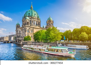 Beautiful view of Berliner Dom (Berlin Cathedral) at famous Museumsinsel (Museum Island) with excursion boat on Spree river in beautiful evening light at sunset, Berlin, Germany