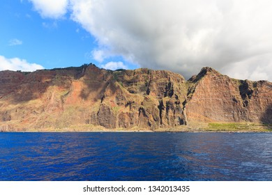 Beautiful view of the big cliffs of the island Madeira, seen from the Atlantic ocean, with the Cabo Girao viewpoint on top