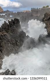 Beautiful view of the big waves crashing at the shore at Porto Moniz, on the north coast of Madeira island