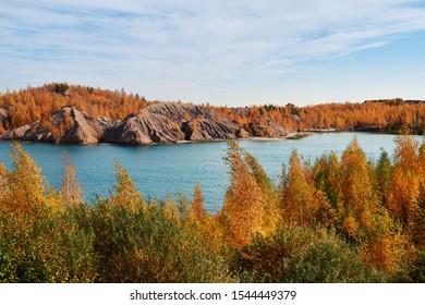Beautiful view of a blue lake surrounded by autumn foliage. Konduki, Tula region, Russia.  - Shutterstock ID 1544449379