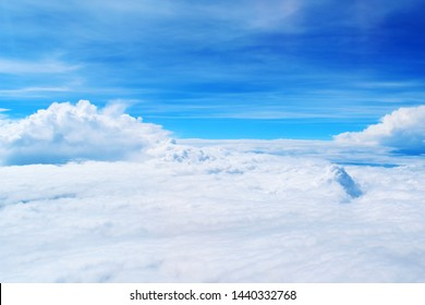 Beautiful view of blue sky. Clouds seen from above
