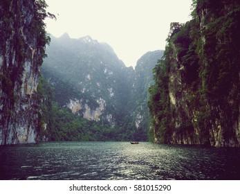 beautiful view of the boat between mountain Ratchaprapha Dam, Choew Lan Dam, THAILAND