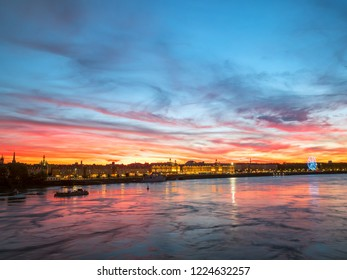 Beautiful view of Bordeaux city and the garonne river with amazing dramatic sunset sky, France.