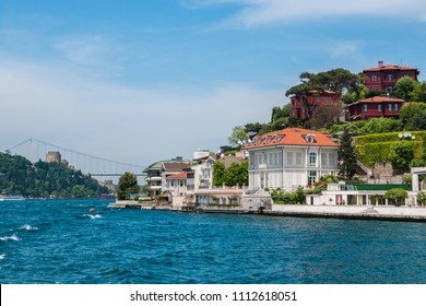 Beautiful View of Bosphorus Coastline in Istanbul with Exquisite wooden Houses and Boat