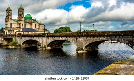 Beautiful view of the bridge over the river Shannon, the parish church of Ss. Peter and Paul with their green domes in Athlone town, wonderful quiet day in the county of Westmeath, Ireland