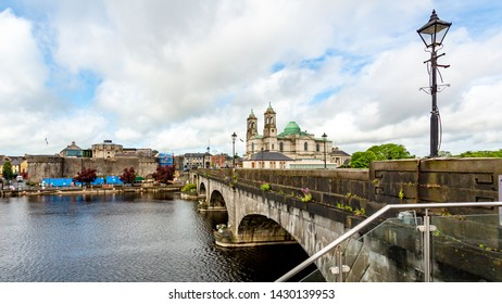 Beautiful view of the bridge over the river Shannon, the parish church of Ss. Peter and Paul and the castle in the town of Athlone, wonderful day in the county of Westmeath Ireland