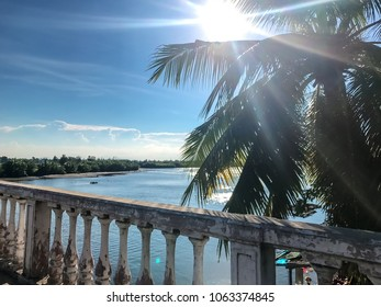 Beautiful view from the bridge to the sea and palm trees. Beautiful view in Vietnam