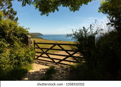 Beautiful view of the British Channel through a gate near the Coastguards Lookout Rescue Station at Veryan Bay in Cornwall
