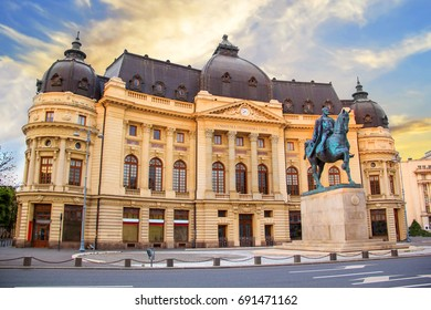 Beautiful view of the building of the Central University Library with equestrian monument to King Karol I in front of him in Bucharest, Romania