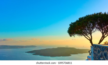 Beautiful view of caldera and Aegean sea at sundown from Santorini island, Greece