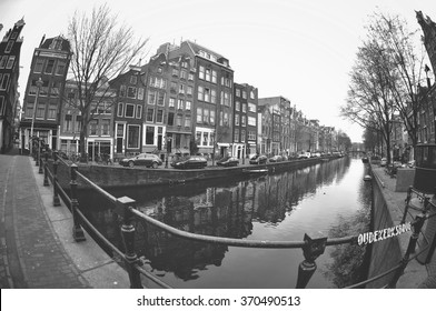 Beautiful view of canals in Amsterdam, Netherlands. Black and white photography taken with fish-eye lens.