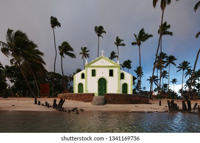 Beautiful view of (Capela de São Benedito) Chapel of St. Benedict and Carneiros Beach (Praia dos Carneiros), Pernambuco, Brazil. Secular Chapel of Carneiros Beach. Church in the beach with palm trees.