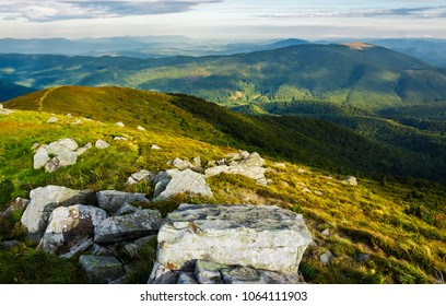 beautiful view of Carpathians in dappled light. wonderful colors of summer landscape in mountains on a cloudy day observed from the top of a hill. location Runa mountain, Ukraine