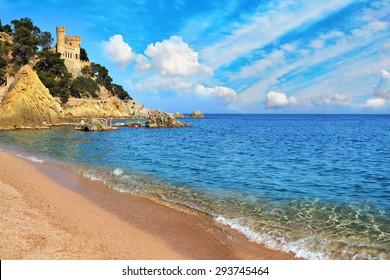 Beautiful view of the Castle Sant Joan on the mountain and sea surf. Lloret De Mar, Costa Brava, Catalonia, Spain
