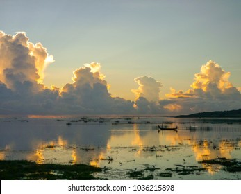 Beautiful view of Chilika lake, Odisha state in India early in the morning with golden sun rise ,white clouds and blue sky