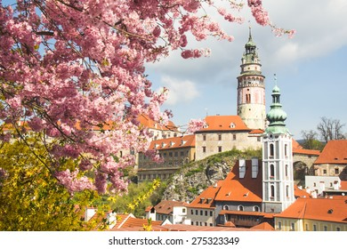 Beautiful view to church and castle in Cesky Krumlov, Czech republic with flower landmarks of Czech.