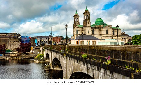 Beautiful view of the city of Athlone with its bridge over the river Shannon, the parish church of Ss. Peter and Paul and the castle, wonderful cloudy day in the county of Westmeath, Ireland