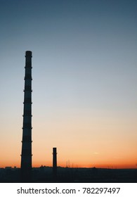 Beautiful view to clear red sunset on industrial chimney background. Moldova beauties. Negative copy space and place for text. Pastel colors