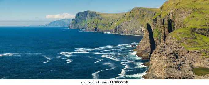 Beautiful view of the cliff Geituskorardrangur at Sunny Day, Vagar, Faroe Islands, Denmark.
