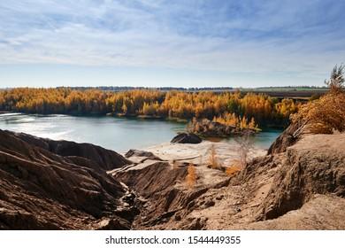 Beautiful view of the cliffs and the blue lake surrounded by autumn foliage. Konduki, Tula region, Russia.  - Shutterstock ID 1544449355