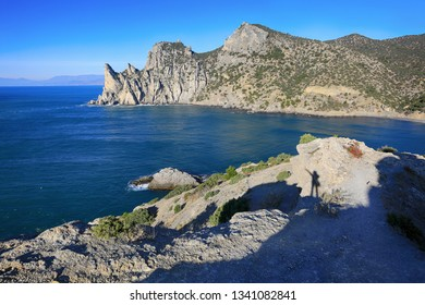 Beautiful view of the cliffs of the Karaul-Oba mountain and the sea on a sunny day. Travel to the coast of Crimea