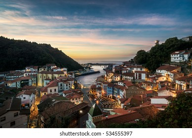 Beautiful view of coastal Asturias sea village Cudilleroin Spain, Europe during sunset or dusk. Gorgeous panorama of nature traditional famous touristic summer destination at dusk or dawn.
