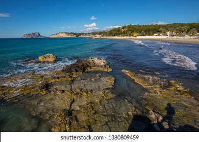 A beautiful view from the coastal town of Moraira, looking towards Calpe Rock and the town of Calpe in the Costa Blanca region of Spain.