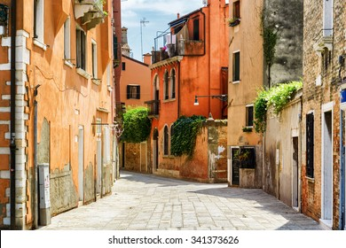 Beautiful view of colorful facades of old houses on street Calle Gradisca Cannaregio in Venice, Italy. Venice is a popular tourist destination of Europe.