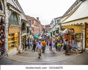 Beautiful view of crowded Streets of Venice from famous Rialto Bridge in Venice, Italy