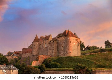 Beautiful view of Château de Dieppe at sunset in Normandy, France, with a vibrant sunset sky