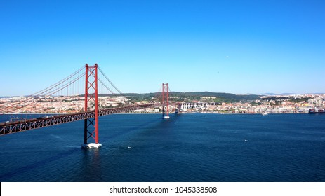 Beautiful view of De Ponte 25 de Abril, a suspension bridge connecting the city of Lisbon, capital of Portugal, to the municipality of Almada on the left (south) bank of the Tagus river.
