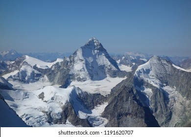 beautiful view to Dent Blanche Mountain while glacier hiking to Bishorn, a 4000m mountain in Valais, Switzerland