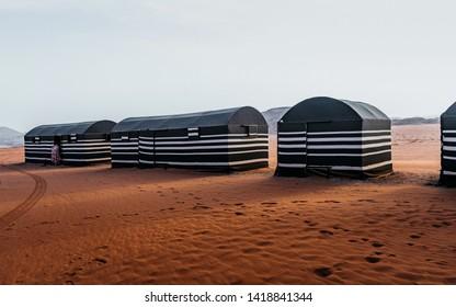 Beautiful view of desert. Tourist tents in Wadi Rum dessert. Camping along the rocks in Jordan