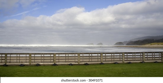 Beautiful view with distant rocks on a cloudy horizon on the Oregon Coast in the fall