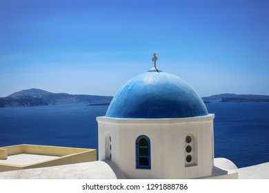 Beautiful view of the dome of the church and the sea on the island of Santorini in Greece