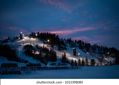 Beautiful view of of a downhill slope lit for night skiing in Steamboat Springs, Colorado, after sunset