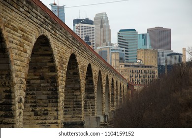 Beautiful view of downtown minneapolis in United States with a close up of the arch bridge