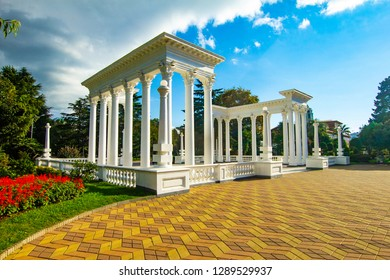 Beautiful view to the elegant white Greek - style colonnades serves as the entrance to the city beach, Batumi, Georgia. Batumi is a stylish resort located in a convenient natural Black Sea bay.