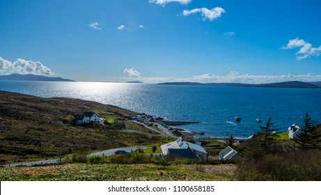 A beautiful view of Elgol Harbour on the Isle of Skye in the Highlands of Scotland. In the distance are the islands of Rum and Eigg