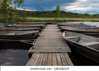 Beautiful view in the evening at the blue hour of row boats at the landing stage at lake Safssjon region Dalarna in Sweden