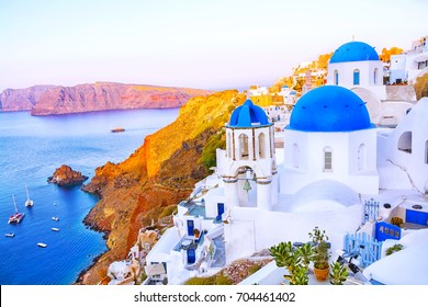 Beautiful view of fabulous picturesque village of Oia with traditional white houses and blue domes of the church in Santorini island at morning, Greece