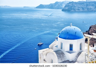 Beautiful view of the fabulous village of Oia with traditional white houses and blue domes of the church in Santorini, Greece
