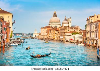 Beautiful view of famous Canal Grande and Basilica di Santa Maria della Salute at sunset in Venice, Italy