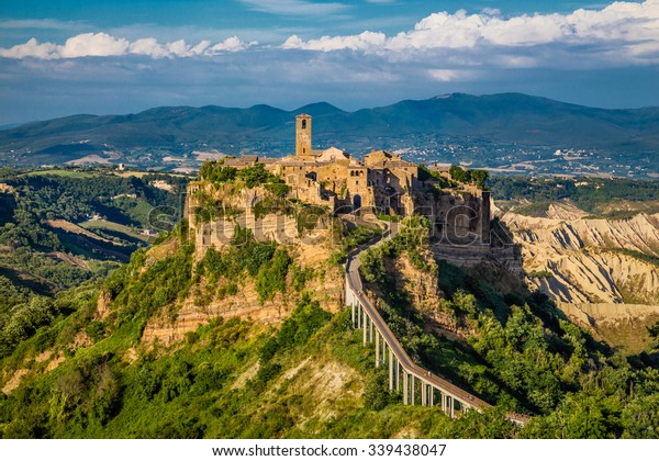 Beautiful view of famous Civita di Bagnoregio with Tiber river valley in golden evening light at sunset, Lazio, Italy