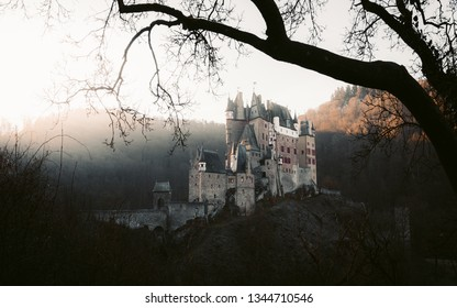 Beautiful view of famous Eltz Castle in scenic golden morning light at sunrise in fall, Wierschem, Rheinland-Pfalz, Germany