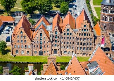 Beautiful view of famous historic Salzspeicher brick storehouse buildings on the Upper Trave River in central Luebeck on a scenic sunny day in summer, Schleswig-Holstein, Germany