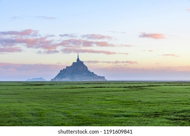 Beautiful view of famous Le Mont Saint Michel abbey on the island, Normandy, Northern France, Europe at sunrise